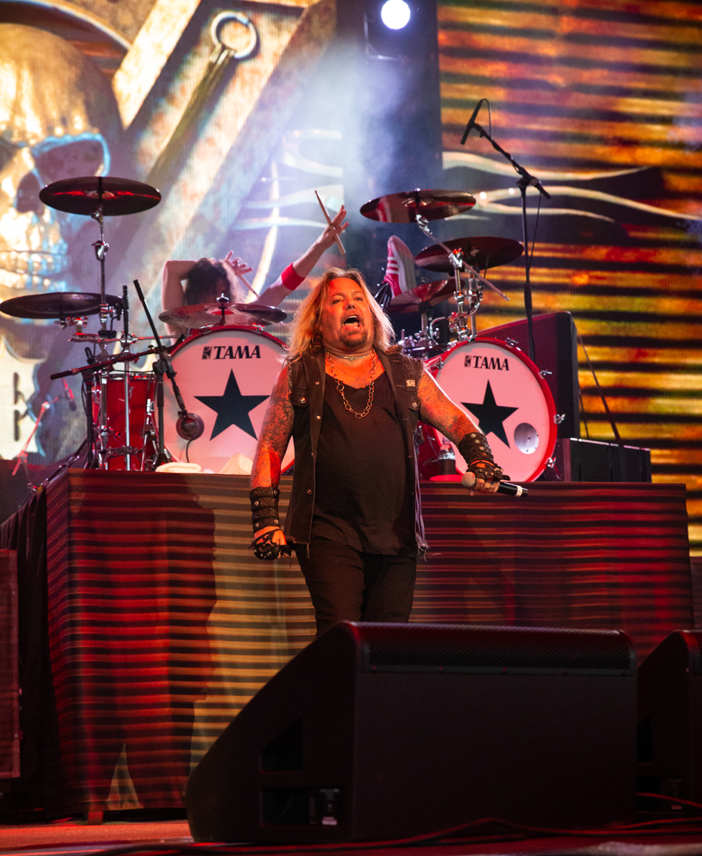 Zoltan Chaney and Vince Neil perform at Hollywood Casino Amphitheatre in Tinley Park, IL on 06/07/2019.