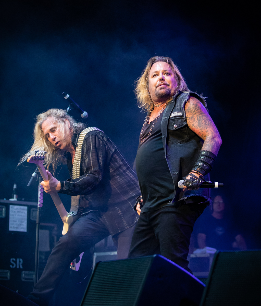 Dana Strum and Vince Neil perform at Hollywood Casino Amphitheatre in Tinley Park, IL on 06/07/2019.