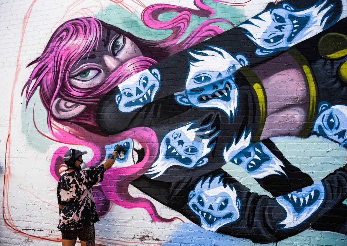 An artist finishes up her piece at Crush Walls 2019   River North Arts District (RINO)   Denver, CO.   09/06/2019   Photos: ©Pix Meyers 2019